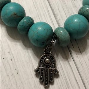 Turquoise bracelet with a hand of God charm